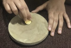 Boost immunity in babies using Gold Coin On Grinding Stone