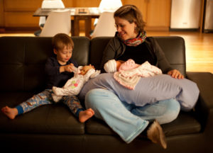 Bottle feeding - Find a comfortable place for you and your baby. Make yourself comfortable with some cushions and anything you need before you start feeding.
